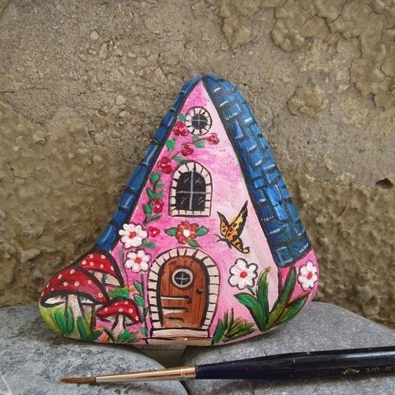 A rock painted like the garden fairies house