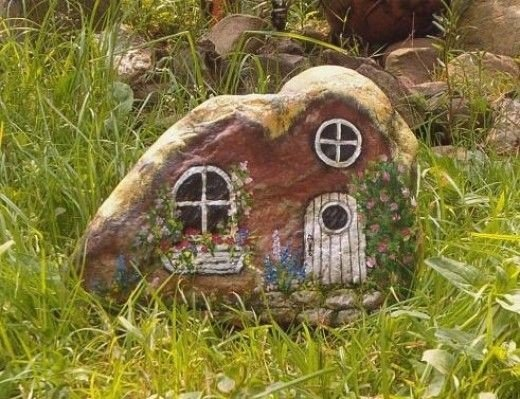 A rock painted like hobbit home