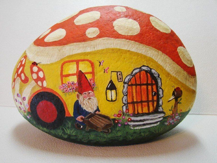 Rock painting of a Gnome Camper under a mushroom roof