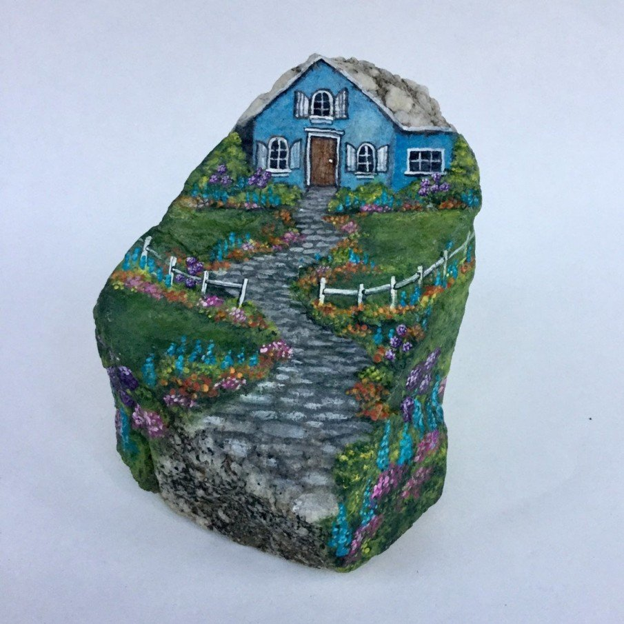 Rock painting Ideas for a house with a garden