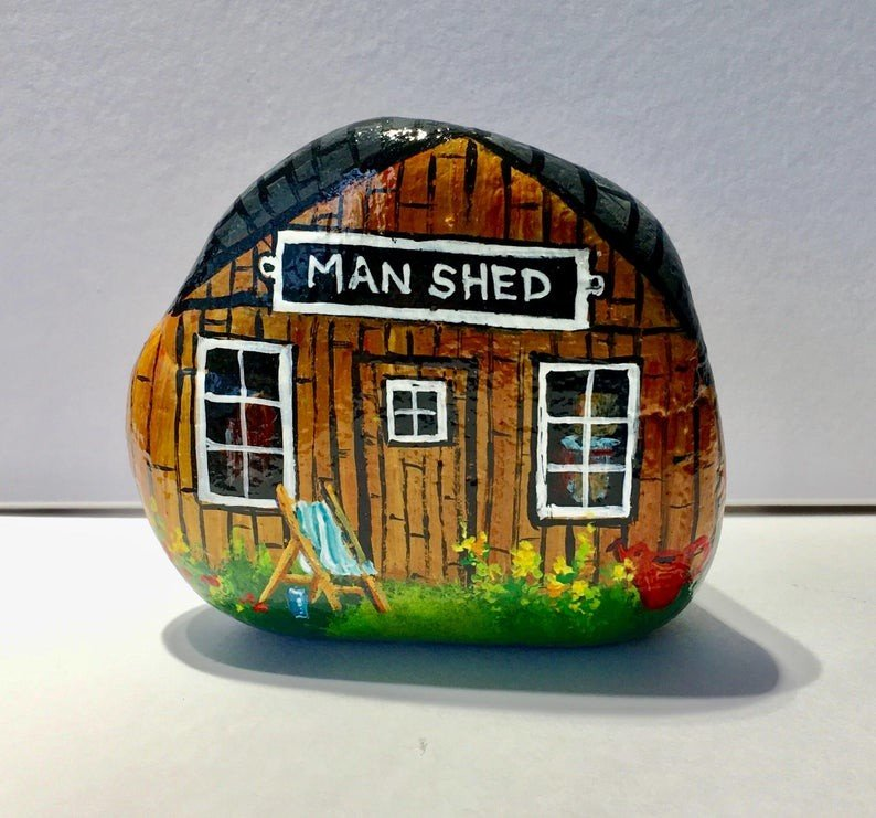 A rock painted like Man Shed