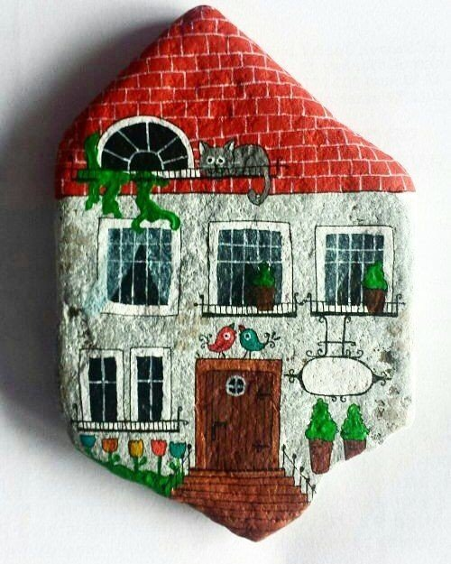 An idea for painting a house on a flat rock