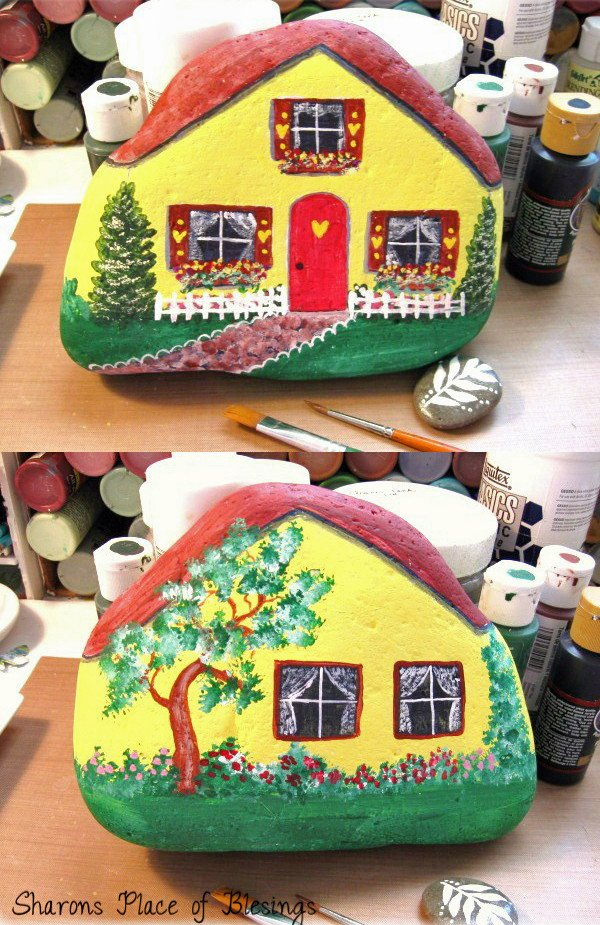 Little rock house is painted on both sides - a great idea for a mini garden