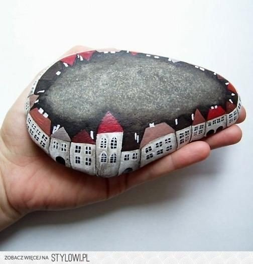 A whole street of homes painted on a rock