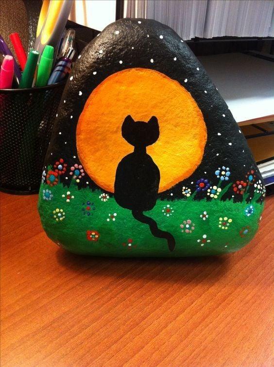 sad cat painted rock idea