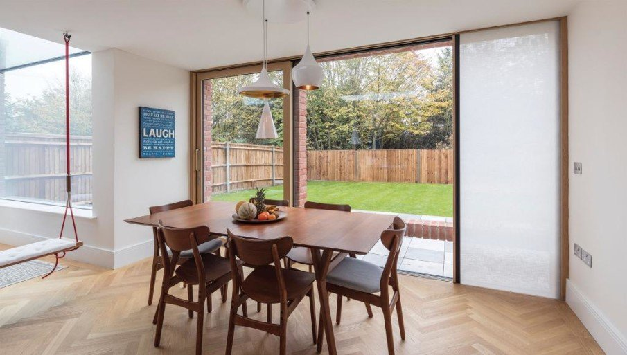 A sliding patio door system with an integrated shade