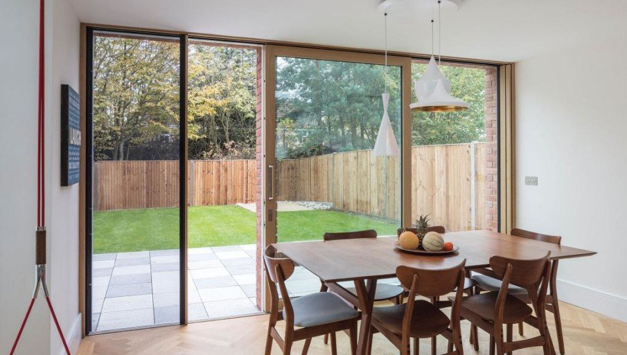 A sliding patio door with an integrated mosquito net