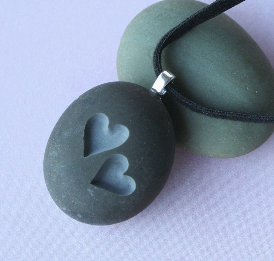 Two hearts pendant idea for rock engraving