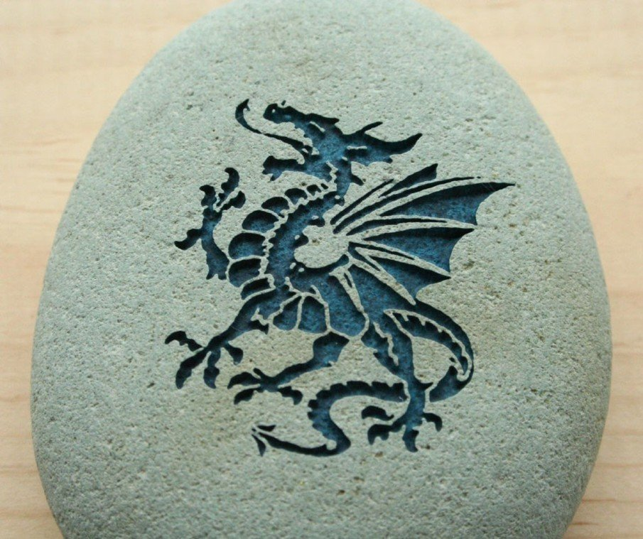 Dragon engraved river rock