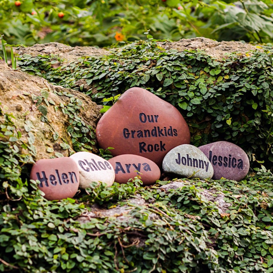 A personalized set of river rocks engraved with Grandkids names
