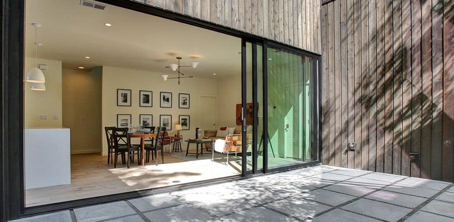 Stacking sliding patio doors by Lacantina Doors