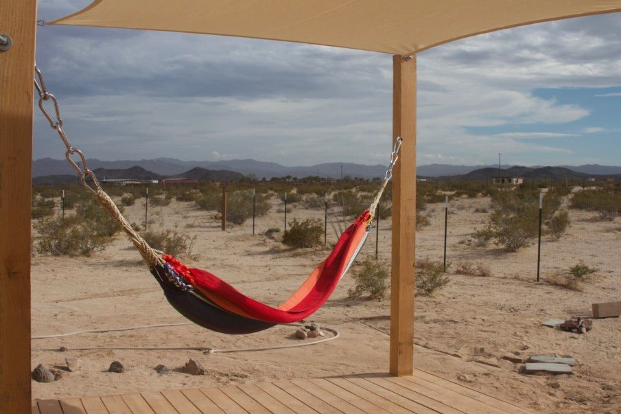 Posts for shade sail double as hammock supports