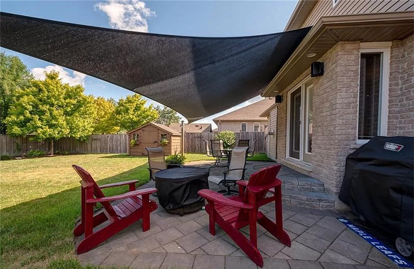 Large sail provides maximum shade to stone patio