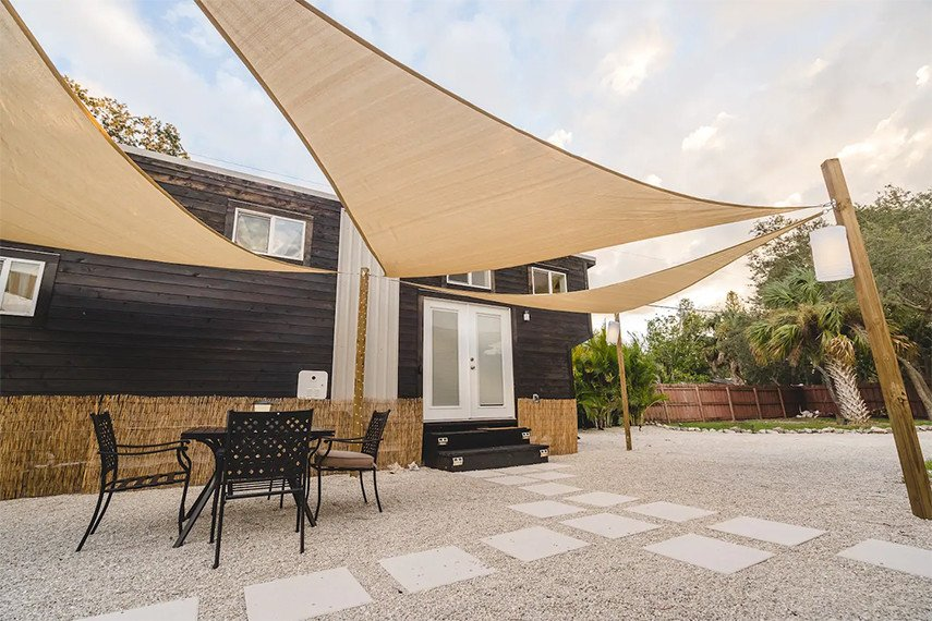 Large patio protected from sun with three shade canopies