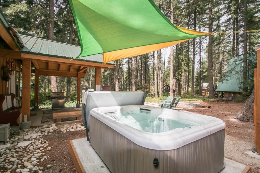 Colorful canopies create visual interest over a hot tub
