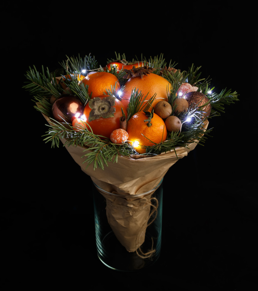 Create Christmas bouquet with seasonal fruits in a tall vase
