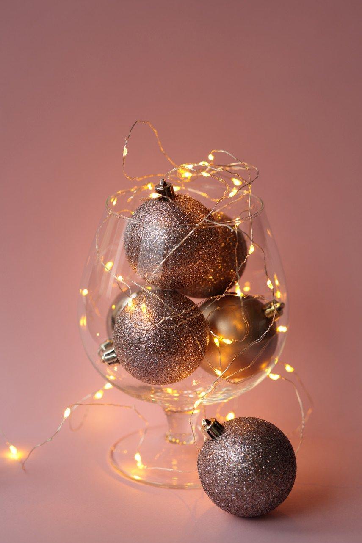 String lights make a brandy glass vase sparkle