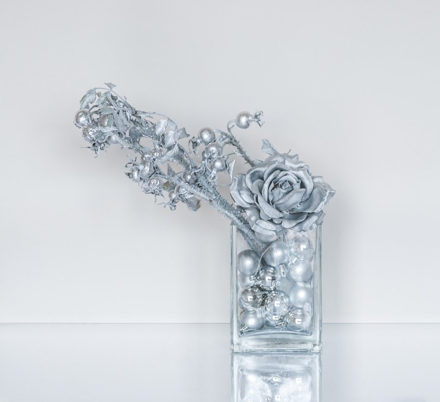 Elegant silver decorations in clear vase