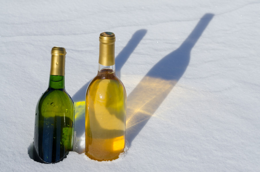 Two bottles of white wine chilling in the snow
