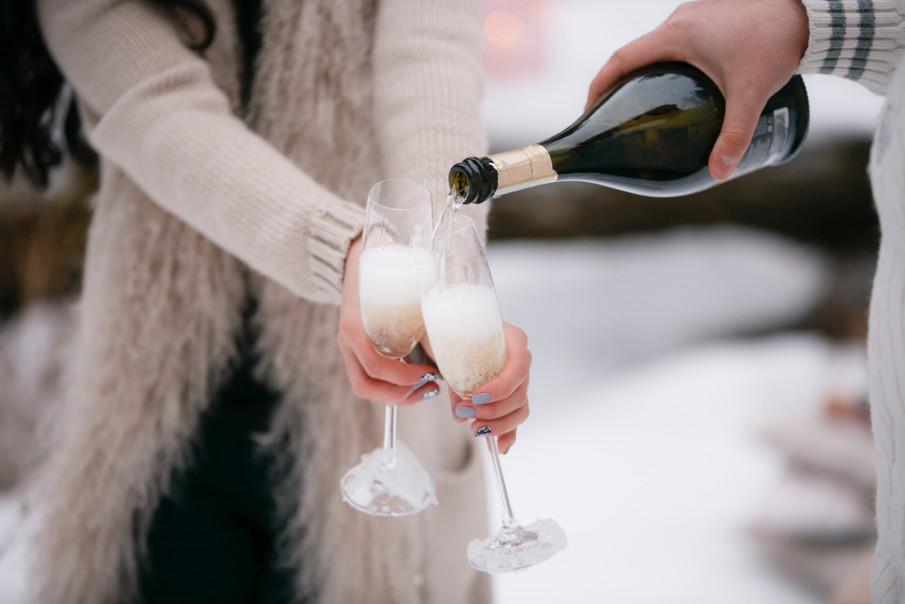 Champagne pouring in two glasses, in winter