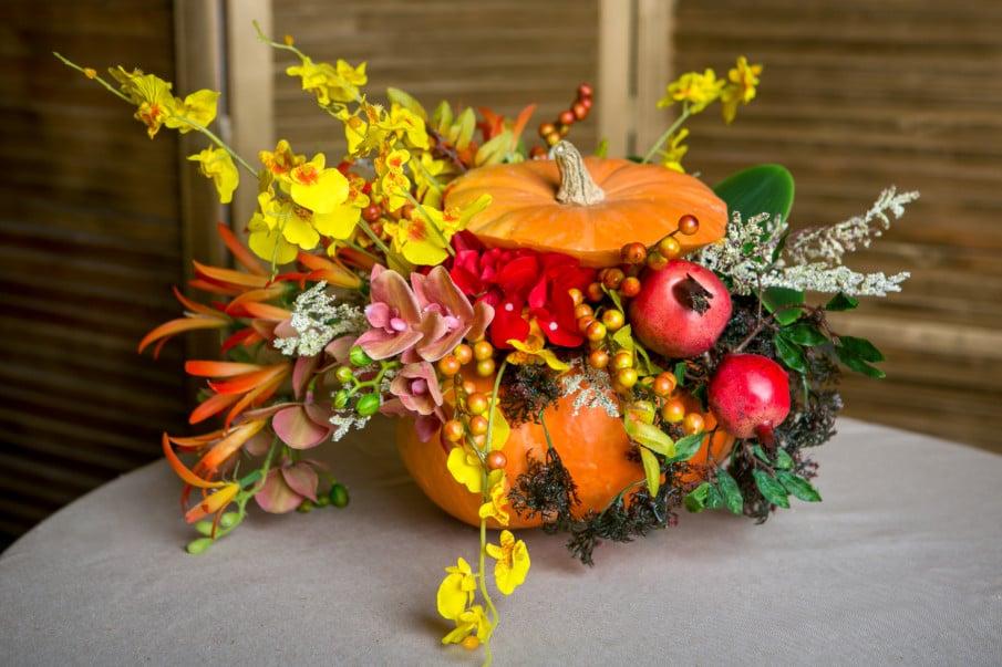 Thanksgiving pumpkin centerpiece made with seasonal fresh flowers