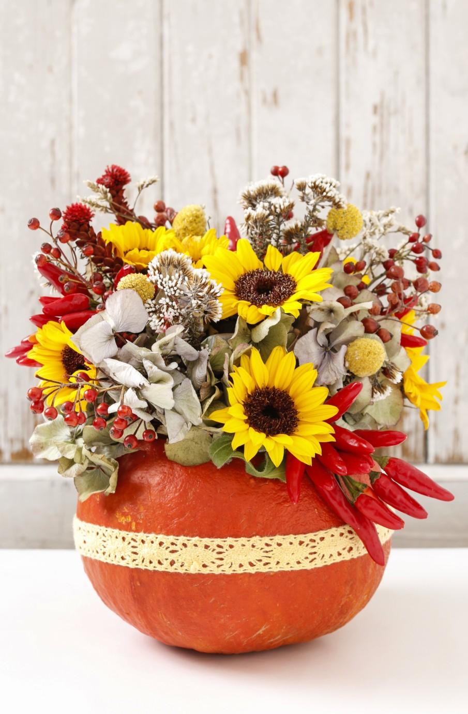 Thanksgiving centerpiece using pumpkin and sunflowers