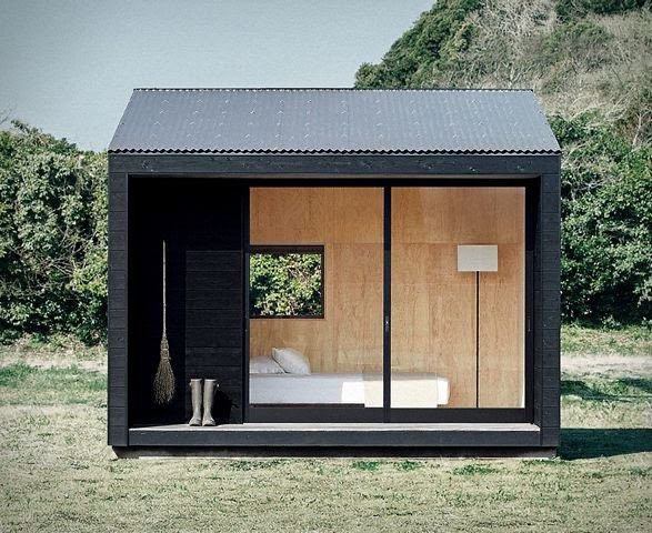A contemporary bunkie with glass facade