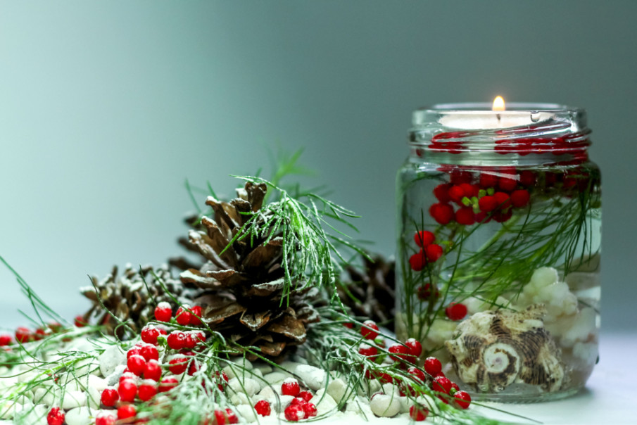 Easy centerpiece idea using mason jar, floating candle and red berries