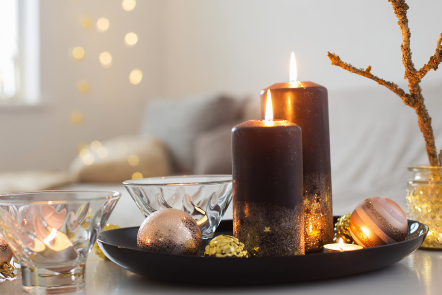 Simple Christmas table centerpieces using pillar candles, glass votives, and shiny ornaments
