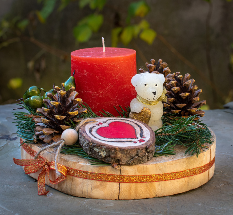 Make a Rustic style centerpiece using a wood charger, wood slice, and red candle