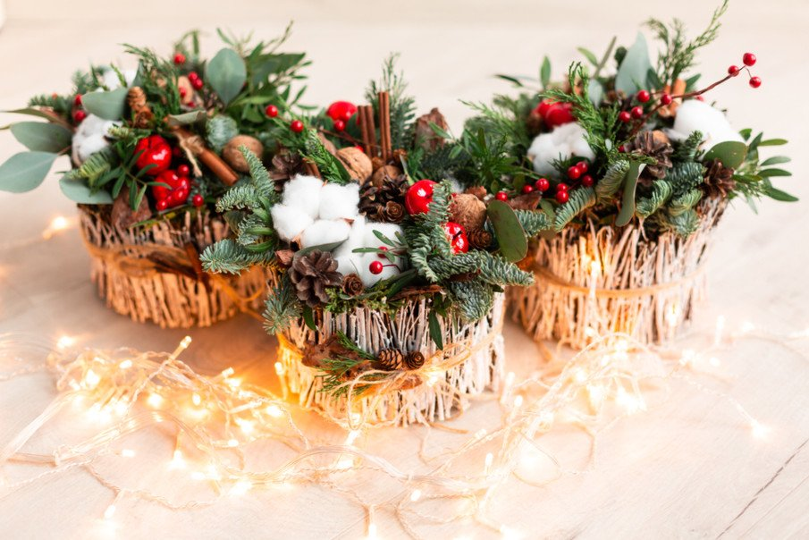 Christmas tabletop decoration with carnations, chrysanthemums santini, brunia, and fir branches