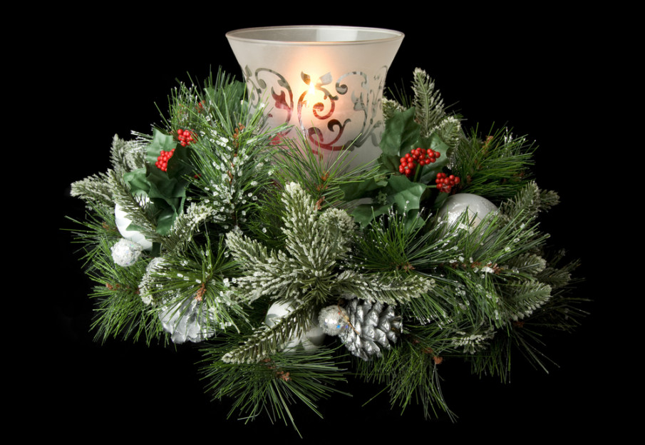 Traditional decor idea combining hurricane lamp with frosted fir boughs