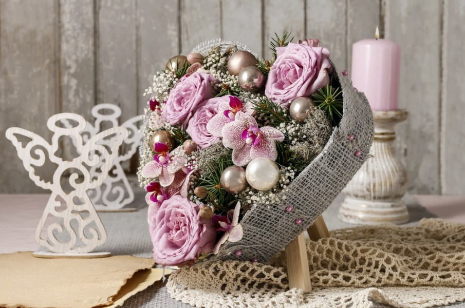 Non-traditional colors centerpiece idea with purple and white flowers in heart-shaped box on a centerpiece easel