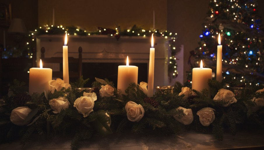 Traditional style large centerpieces idea using roses and fir boughs with taper and pillar candles