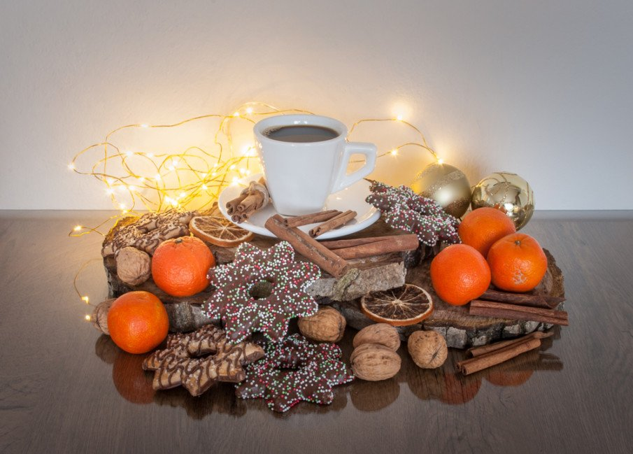 Arrange cinnamon sticks, oranges, and nuts for a classic Christmas centerpiece
