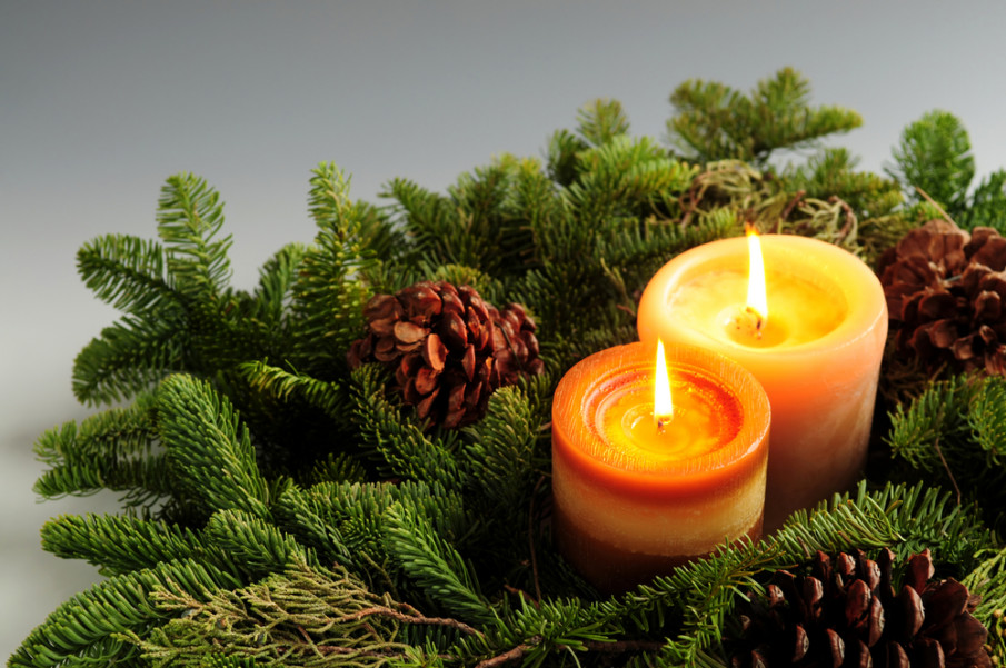 Create a holiday tabletop centerpiece with fir branches and candles