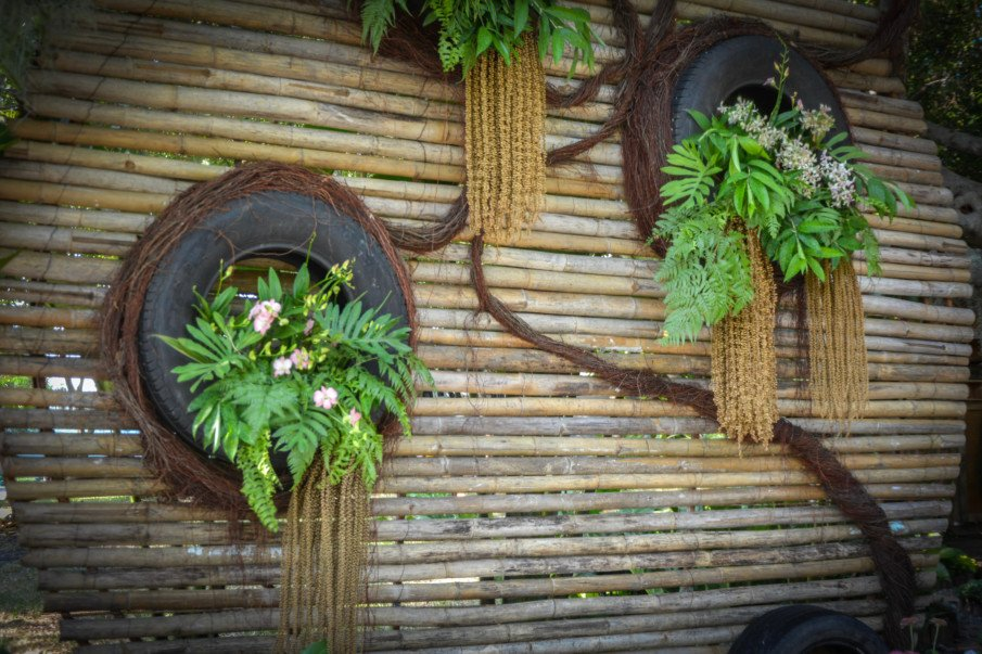 hanging tire planters on a bamboo wall