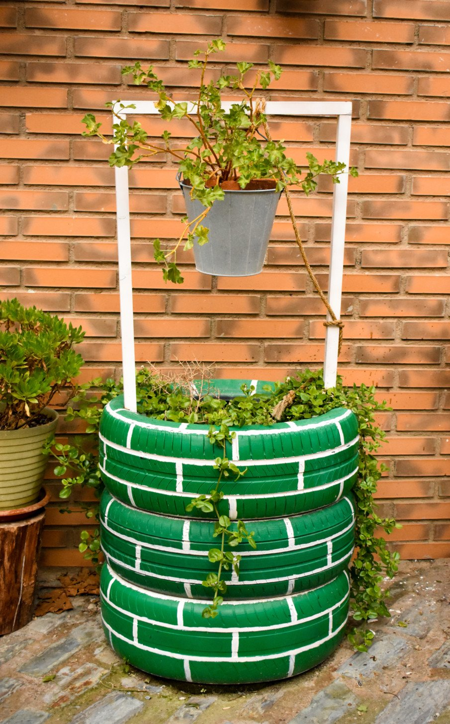 tire planter designed as a wishing well