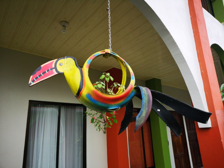 hanging tire planter designed like a toucan