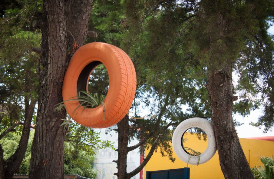 hanging tire planters attached to trees