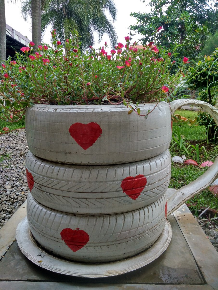 tall teacup tire flower pot decorated with hearts