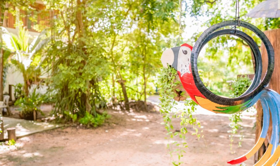 hanging tire planter designed like a parrot