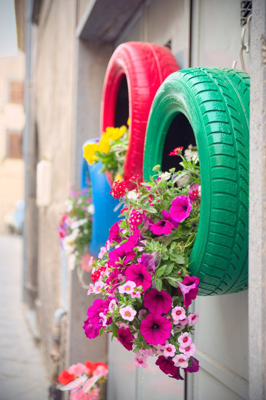 side view of hanging tire planters