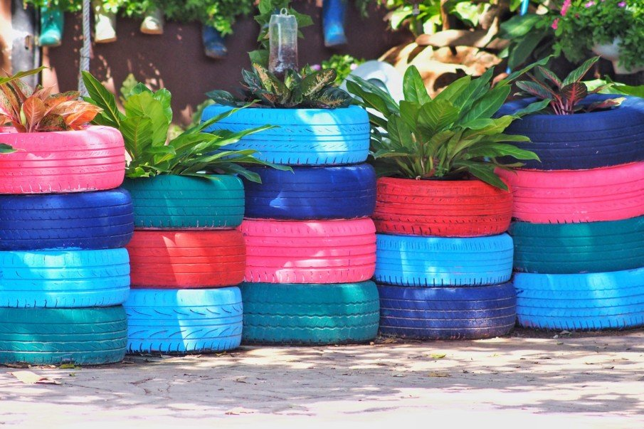 low wall of stacked painted tire planters
