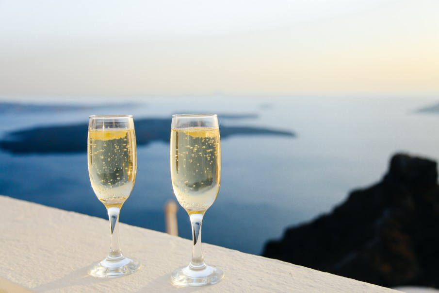 two glasses of sparkling wine with a sea view