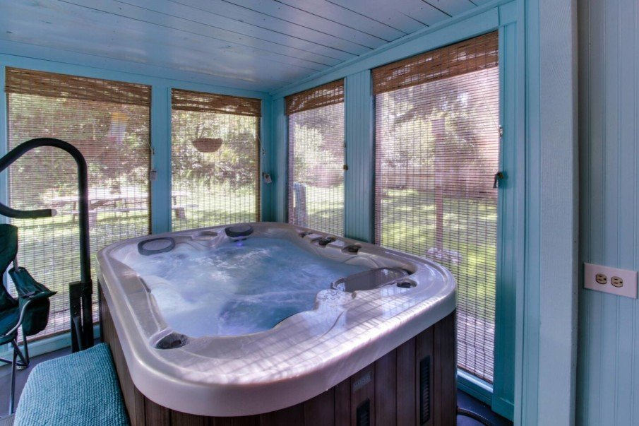 Year-round hot tub enclosure idea designed for maximum privacy