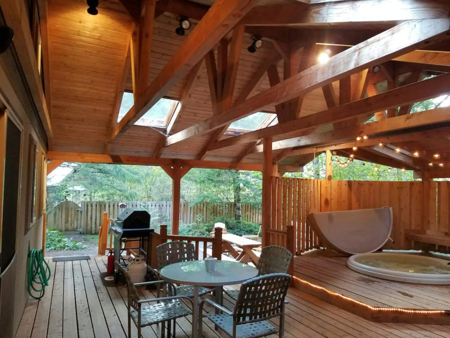 Spacious hot tub pavilion that includes room for entertaining