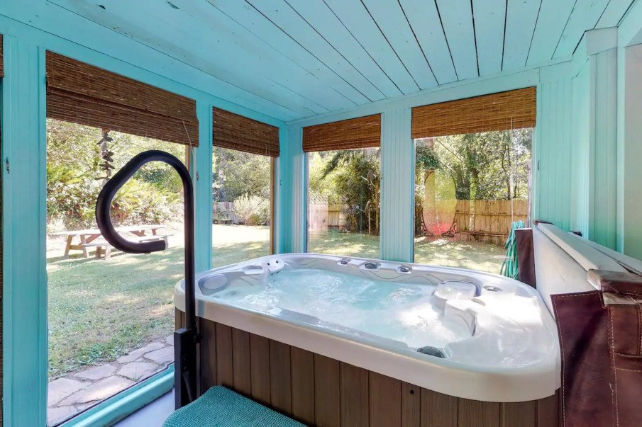 Hot tub enclosure made functional with adjustable blinds