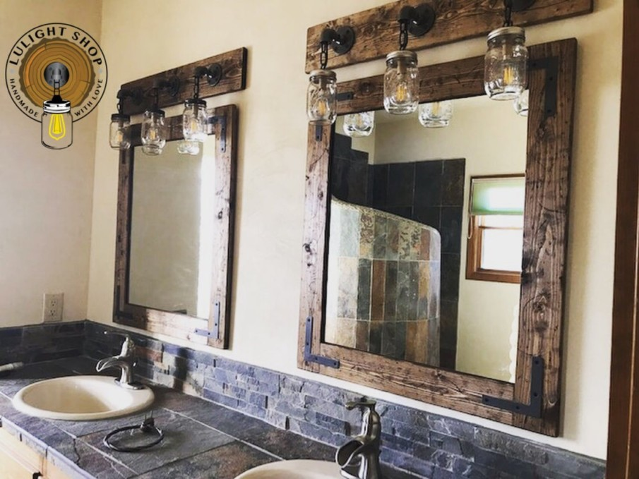 Two rustic wooden mirrors with metal accents in a rustic style bathroom