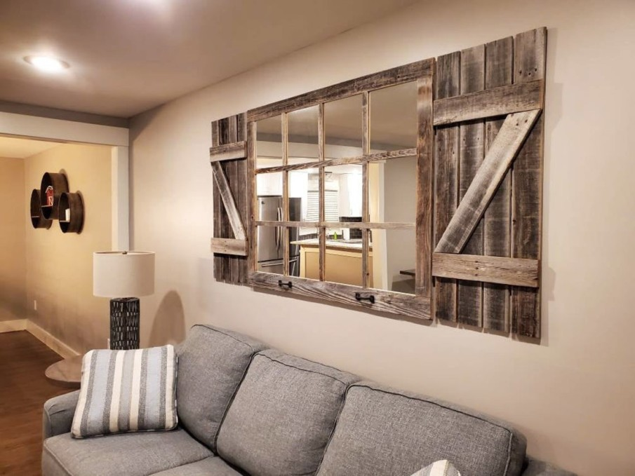 Wall Hung Rustic Windowpane Mirror with Shutters above the Sofa